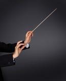 Muzyczny dyrygent z batutą Zdjęcia Royalty Free