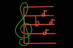 muzyczny neon notatki znak Fotografia Royalty Free