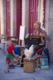 Muzyk na ulicznej bawić się muzyce w Porto, Portugalia Zdjęcia Stock