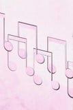 Muzyk notatki na różowym tle zdjęcie stock