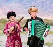 Muzyk sztuki tradycyjni instrumenty w Issyk Kula Zdjęcia Royalty Free