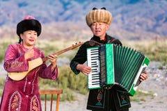 Muzyk sztuki tradycyjni instrumenty w Issyk Kula Fotografia Stock