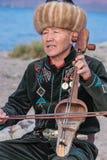 Muzyk sztuki tradycyjni instrumenty w Issyk Kula Zdjęcie Stock