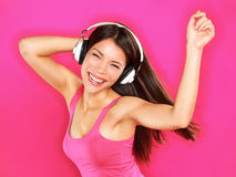 Muzyka - kobieta jest ubranym hełmofonów tanczyć Obraz Royalty Free