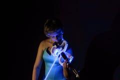 Muzykalna dama przy nocą Zdjęcia Stock