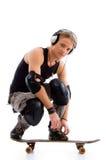 muzyki deskowa słuchająca męska łyżwa Fotografia Stock