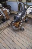 Muzzle loading cannon on sailing ship Stock Photos