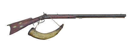 Muzzle loading rifle and powder horn isolated. Stock Photos
