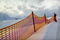 Muzzle red grid on a ski slope in  evening. Royalty Free Stock Photography