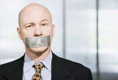 Muzzled Businessman Royalty Free Stock Photo