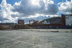 Mv Falkbris unloads timber Stock Images
