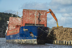 Mv Falkbris unloads timber Royalty Free Stock Images