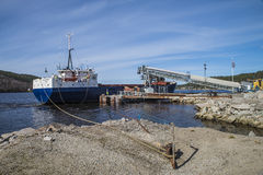 Mv Falknes arrivals Bakke harbor to load gravel Royalty Free Stock Images