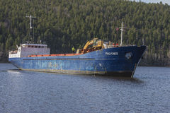 Mv Falknes arrivals Bakke harbor to load gravel Stock Photo