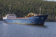 Mv Falknes arrivals Bakke harbor to load gravel Stock Photo