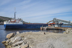 Mv Falknes arrivals Bakke harbor to load gravel Royalty Free Stock Image