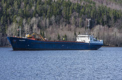 Mv Falknes arrivals Bakke harbor to load gravel Stock Photography