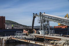 Mv Falknes load gravel at Bakke harbor Stock Photography