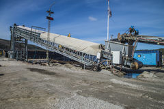 Mv Falknes load gravel at Bakke harbor (conveyor belts) Royalty Free Stock Image