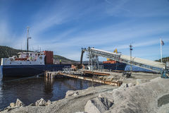 Mv Falknes load gravel at Bakke harbor Royalty Free Stock Images