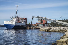 Mv Falknes load gravel at Bakke harbor Stock Photos