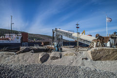 Mv Falknes load gravel at Bakke harbor Stock Photography