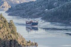 MV Hagland Captain sails through the Ringdalsfjord Royalty Free Stock Image