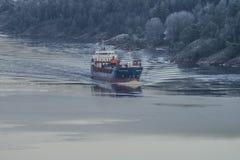 MV Hagland Captain sails through the Ringdalsfjord Royalty Free Stock Photo