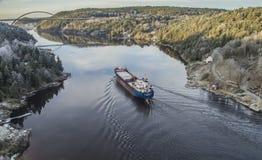 MV Hagland Captain sails through the Ringdalsfjord Royalty Free Stock Images