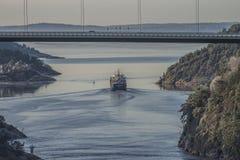 MV Hagland Captain sails through the Ringdalsfjord Royalty Free Stock Photos
