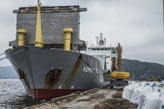 Mv Komet III unloads chemical goods Stock Image