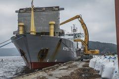 Mv Komet III unloads chemical goods stock photo