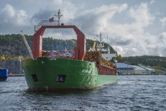Mv st.pauli. Leaving Halden, (Norway) harbor with a cargo full of timber. Photo is shot 9 October 2013. Vessel's Details: Ship type: General cargo, Year Built Royalty Free Stock Photography