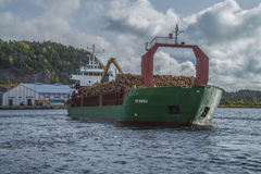 Mv st.pauli. Leaving Halden, (Norway) harbor with a cargo full of timber. Photo is shot 9 October 2013. Vessel's Details: Ship type: General cargo, Year Built Stock Photo