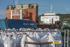 MV Wilson Humber. Situated on the quayside in Halden, Norway harbor and unloads fertilizer. Some facts about Wilson Humber: Type: General Cargo, Gross Tonnage Stock Image
