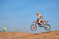 MX athlete on the bike landed on hillside Stock Photo