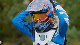 MX moto Girl in a helmet - cross racing Royalty Free Stock Photos