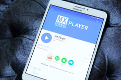 Mx player app. Downloading mx player application from google play store on samsung tablet Royalty Free Stock Photos