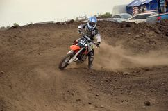 MX racer boy performs the rotation on a motorcycle Stock Photography
