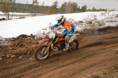 MX racer rides in descent on the motocross track Stock Photos