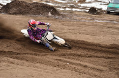 MX racing driver at the turning in the sandy ruts Stock Images
