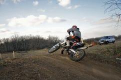 MX rider on rides mound performs scrub Royalty Free Stock Photo