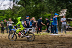 MX rider finish the race. Motion blur with flying dirt. Uzhgorod, Ukraine - May 21, 2017: MX rider Finish the race. Motion blur with flying dirt. TransCarpathian stock image