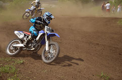 MX rider on motorcycle is accelerating at the exit Stock Image