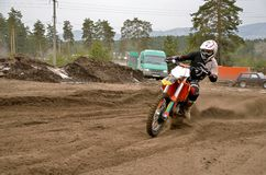 MX rider on a motorcycle in a bend. MX racer on a motorbike acceleration out bend on track motocross stock image