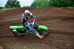 MX rider turns on a dirt hill Royalty Free Stock Image