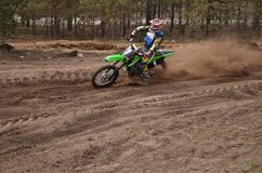 MX rider turns point-blank of sand Stock Photography
