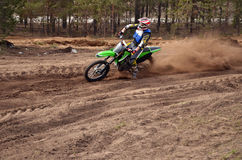 MX rider turns point-blank of sand Royalty Free Stock Image