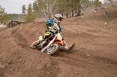 MX rider veering point-blank of sand with Royalty Free Stock Photo