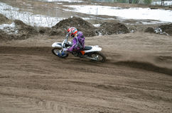 MX rider veering point-blank of sand with Royalty Free Stock Photography